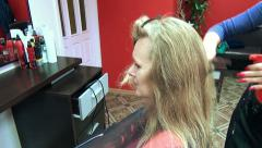 Woman barber's chair. Hairdresser moisturize long blonde hair Stock Footage