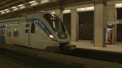 Commuter train station platform Stock Footage