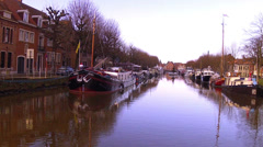 Houseboats on the canal of Brugge (Belgium). Stock Footage