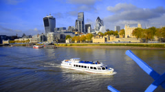 Boats on thames river and london skyline, wide angle cityscape lit by the sun Stock Footage