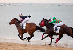 horse race on sanlucar of barrameda, spain, august  2010 - stock photo