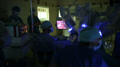 Team of surgeons performing an operation on a patient in a hospital Stock Footage