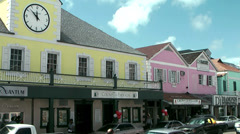 Nassau_005HD, colored Houses and much Car Traffic in the Main Street Stock Footage