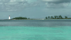 Nassau_018HD, Spit of Land with Lighthouse behind turquoise Water Stock Footage