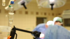 Team of surgeons performing an operation on a patient in a hospital - stock footage