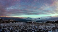 Fog descending the mountain slope. Timelaps Stock Footage