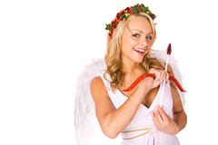 cupid: looking for love with bow and arrow - stock photo