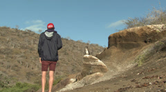 P03150 Person watching Blue Booby at Galapagos Stock Footage