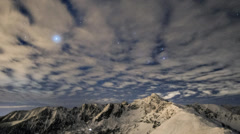 Clouds and stars over the mountains (2) Stock Footage