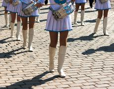 Drummer girls march on city day Stock Photos