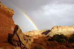 rainbow and brief dramatic sunshine - stock photo