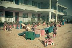 Children playing in schoolyard, aaryan school, pune, maharashtra, india Stock Photos