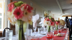 Wedding head table and bouquet flowers rack focus - stock footage
