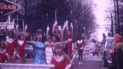 8mm Vintage Film 1969 Teen Girls Cheerleaders Twirling Batons  Parade Street Stock Footage