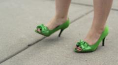 Green wedding high heels playful twist and stomp Stock Footage