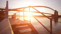 Sun flare. romantic sunset. bridge landscape. lake pond Stock Footage