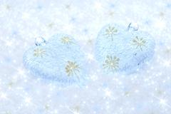 Christmas decorations on a background of brilliant snow Stock Photos