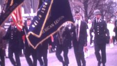 8mm Vintage Film 1969 Christmas Parade Flags Military Soldiers Veterans Marching Stock Footage