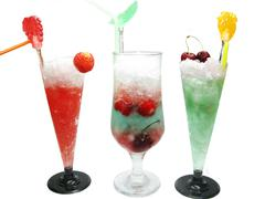 Three alcohol liquer cocktail drinks with fruit Stock Photos