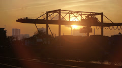cranes moving container. industrial industry business. time lapse at sunset - stock footage