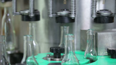 Complete and empty bottles of cognac on a conveyer Stock Footage