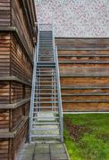 steel stairs on a wooden building - stock photo