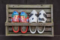Wooden shoes in a rack Stock Photos