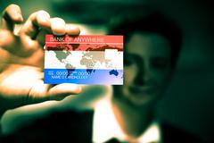 Stock Photo of close up to credit card in man hand, flag of netherlands