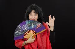 geisha shows long life and prosperity gesture - stock photo