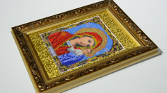 Work by a bead  in a frame,executed  with a cardboard Stock Footage