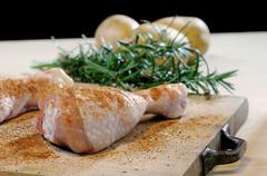 chicken thighs with rosemary and potatoes - stock photo