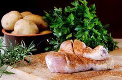 chicken thighs with potatoes - stock photo