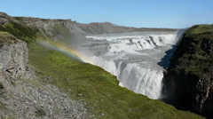 Panoramic view of the Gullfoss waterfall with a rainbow and tourists, Iceland - stock footage