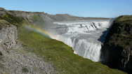 Stock Video Footage of Panoramic view of the Gullfoss waterfall with a rainbow and tourists, Iceland