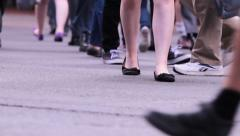 Crowd legs at a busy intersection crossing Stock Footage