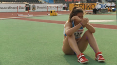 Athlete crying after an unsuccessful jump - stock footage