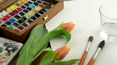 Prepairing for watercolor painting of a tulip Stock Footage