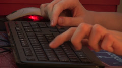 Teenage hands typing at keyboard, closeup, mouse, desk, studying Stock Footage