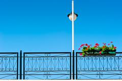streetlight and pot with beautiful flowers - stock photo