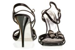 a pair of beautiful black sandals with heels - stock photo