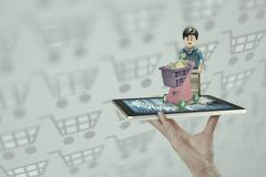 Shopping cart over a tablet pc Stock Illustration