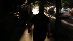 Silhouette of Man Walking Away From Camera Stock Video - stock footage