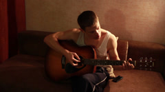 Young guy playing guitar, Full HD 1080 Stock Footage