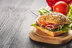 Sandwich with ham, tomatoe and radish Stock Photos