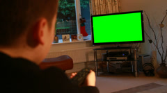 Boy watching LED TV with green chroma key (model release) Stock Footage