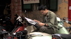 Honda Man Reads Newspaper Stock Footage