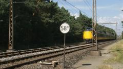 Train of Dutch Railways in Veluwe landscape Stock Footage