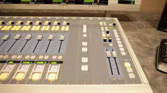Pan Back and Forth of Mixing Board in Small Studio Stock Video Stock Footage