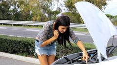 Stunning female model desperate about broken car Stock Footage
