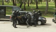 A group of soldiers stopped the car and arrested the perpetrator - stock footage